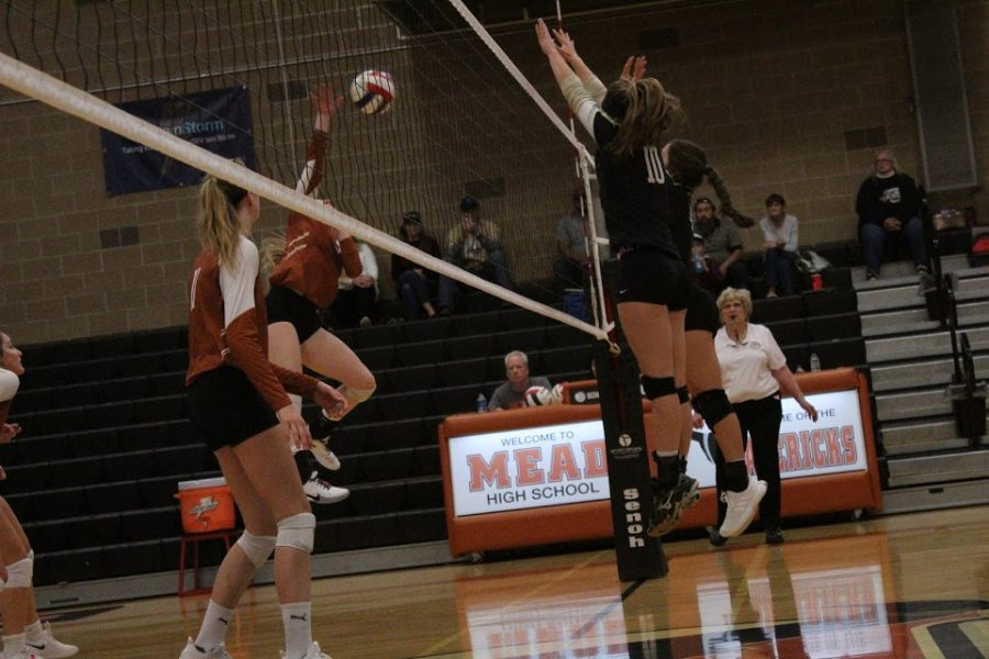 picture by Campbell Goter: Kenzie Morton '21 Spikes ball in Canon City matchup.