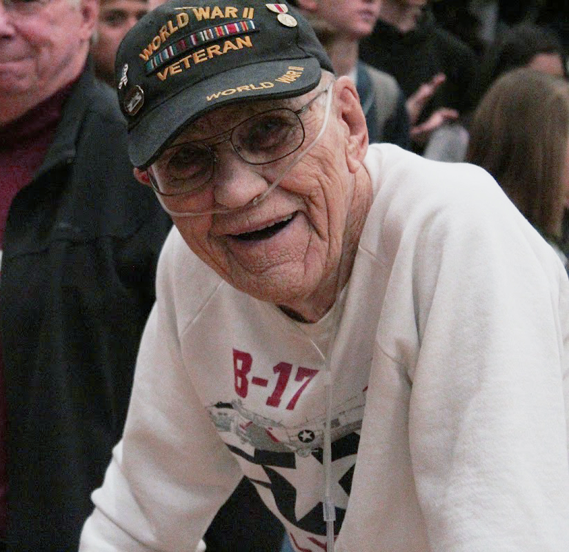 WWII Veteran sitting at Mead High School's Veteran's Day Assembly