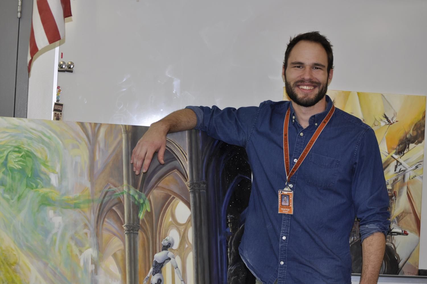 McHugh standing next to his biggest painting.