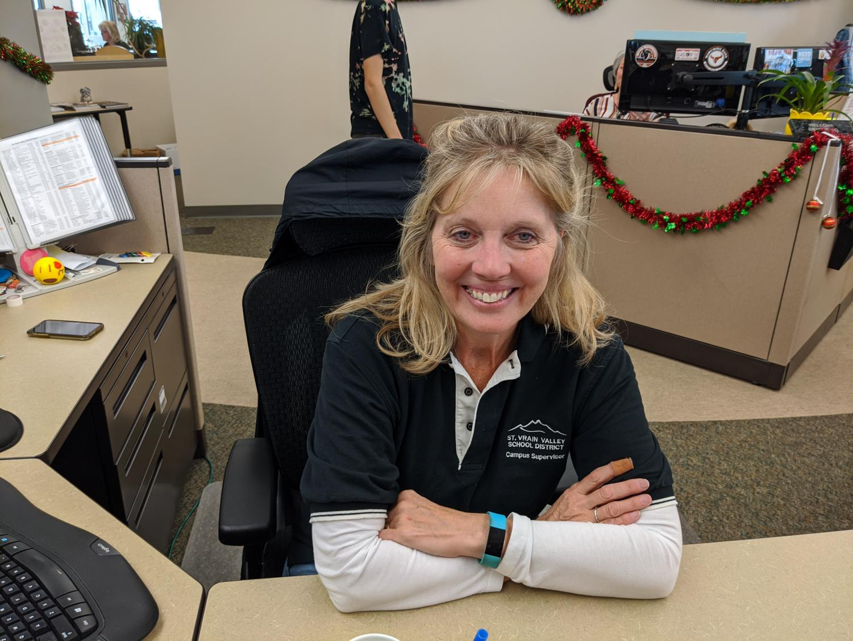 Campus supervisor Penni Andersen sitting  at her desk.