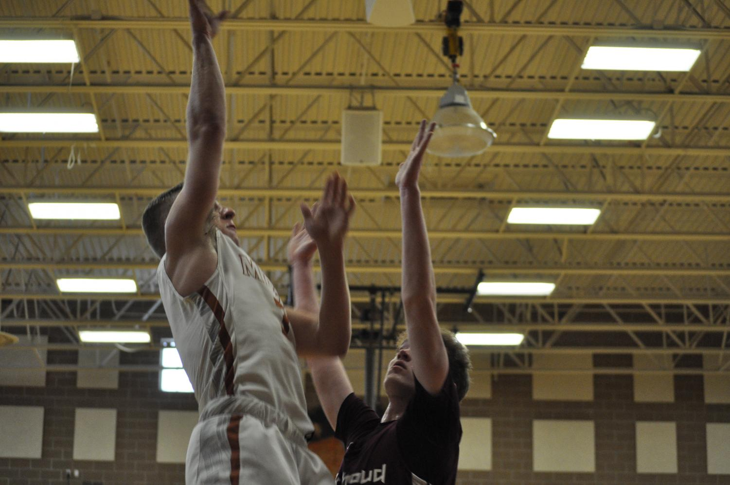 Will Maher making a shot against Berthoud.