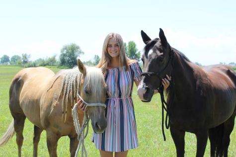 Senior Kohley Longmeyer poses with her horses.