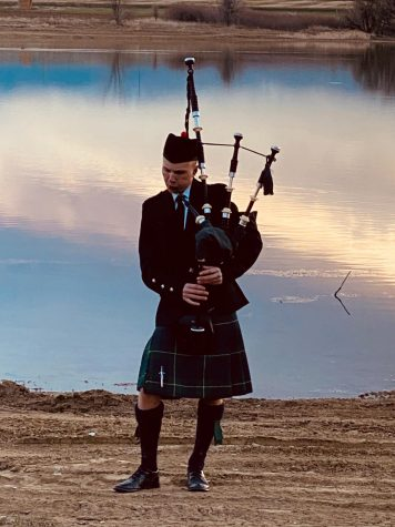 Ashton Steele plays the bagpipes in the Sunset Solidarity Movement.