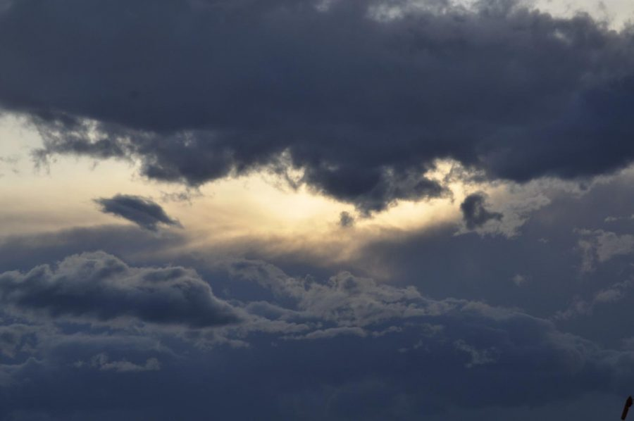 Sun gently reaching through the clouds.