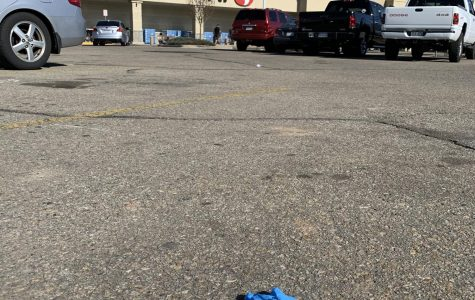 People are being irresponsible by leaving their gloves in the parking lots of stores.