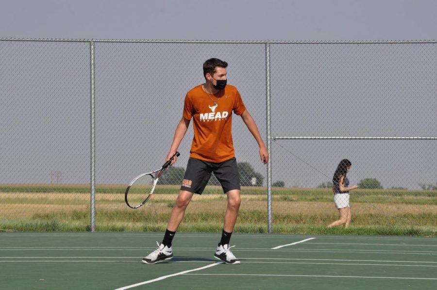 Student Zackerie Mortensen '22 at a tennis match.