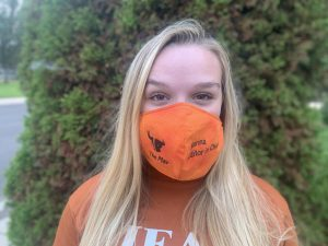 The Mav's Editor in Chief Marina Goter sports her mask to encourage others to be safe.