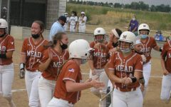 The softball girls celebrate Wiesecamps grand slam during their game vs Holy Family.