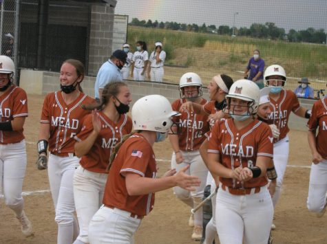 The softball girls celebrate Wiesecamp's grand slam during their game vs Holy Family.