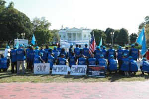 A picture taken by Kuzzat Altay depicts a group of people gathered on Pennsylvania Avenue in front of the White House in order to address and protest the Uighur genocide in China.