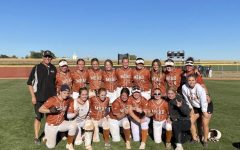 Mead celebrates their impressive performance in the regional tournament.